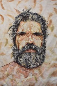Title: Michael Robinson From: Yuin country Materials: Chalk pastel and charcoal on eco dyed fabric using bloodwood and stringy bark gum leaves Measurements: 140cm x 110cm Permission to draw this person was given by Michael Robinson himself. For Sale: Please Inquire